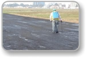 Top sealing soil stabilized road with AggreBind